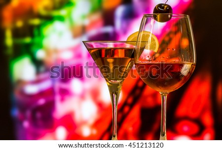 Wine glass on colorful background