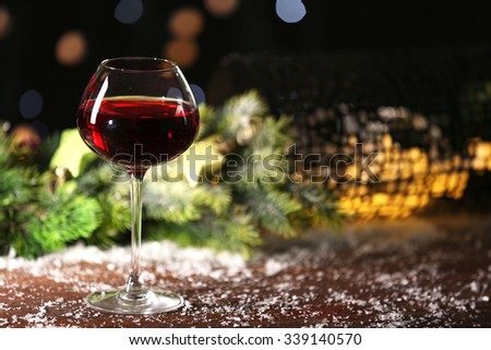 Wine glass on decorated wooden table - stock photo
