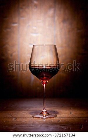 Wine glass on old wooden background - stock photo