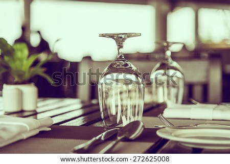 Wine glass on table in restaurant - vintage filter