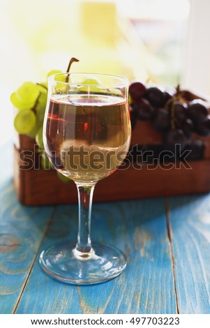 Wine glass on the table and grapes
