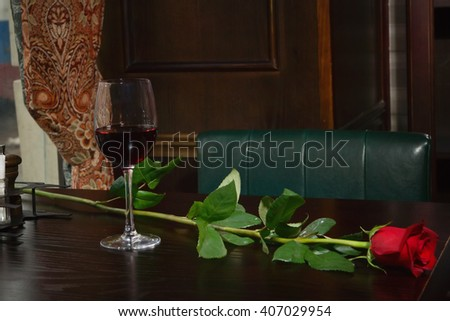 wine glass on the wooden table at restaurant - stock photo