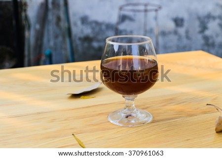 Wine glass on wooden table in natural light