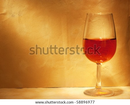 wine glass on yellow paper background with copy-space