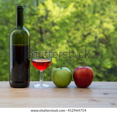 wine glass red and green apple on table - stock photo