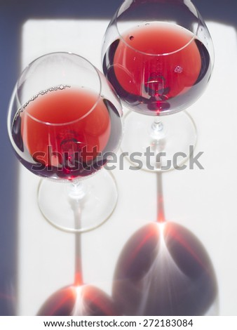 Wine glass reflection on counter top - stock photo