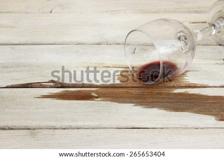 Wine glass upside down on a wooden table - stock photo