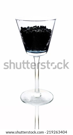 Wine glass with coffee beans on white background clipping path