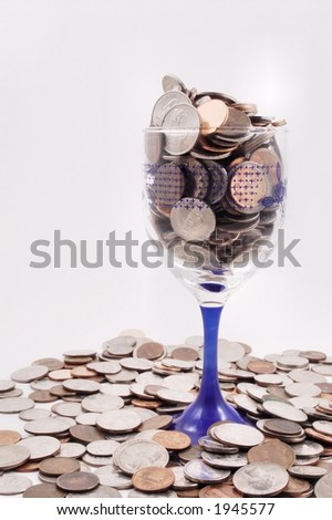 Wine Glass with Coins - stock photo