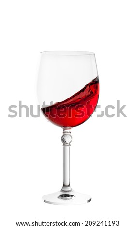 wine glass with splash of wine isolated on white background