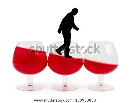 Wine glasses and alcoholic man isolated on white background - stock photo