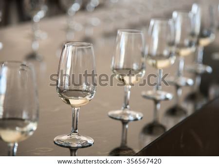 Wine glasses in a row for testing white and red wine