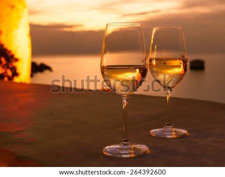 Wine glasses next to a beautiful setting - stock photo