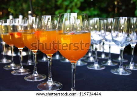 Wine glasses of punch ready at wedding reception - stock photo