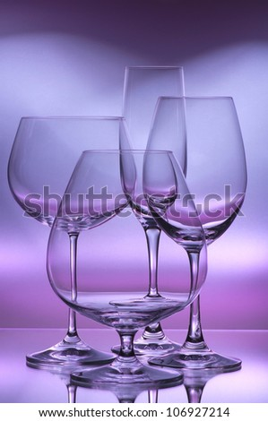 wine glasses on a color background