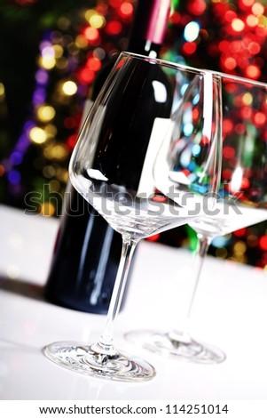 Wine glasses on Christmas tree background - stock photo