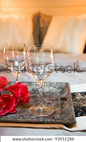 wine glasses on tea-tray in the bed of a luxury yacht.