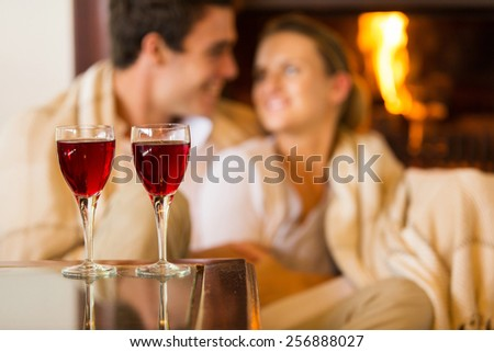 wine glasses on the table with couple on background