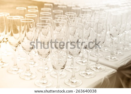 Wine glasses on the table with old fashion style. - stock photo
