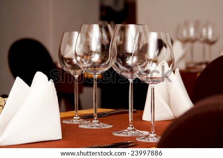 Wine glasses served on a table in restaurant