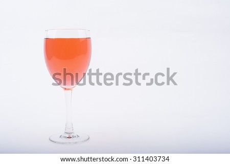 Wine Glasses with Brightly Colored Water on a White Background - Pink