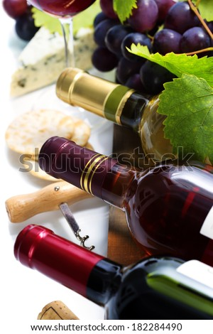 Wine, grape and cheese over white - stock photo