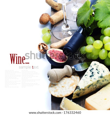 Wine, grape and cheese over white. With easy removable sample text - stock photo