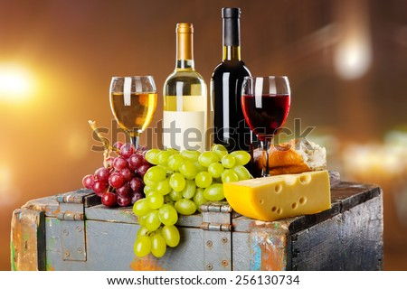 Wine, grapes and cheese still life - stock photo