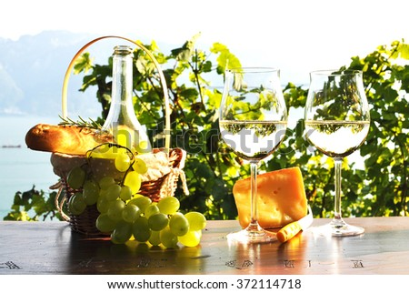 Wine, grapes, bread and cheese. Lavaux region, Switzerland - stock photo