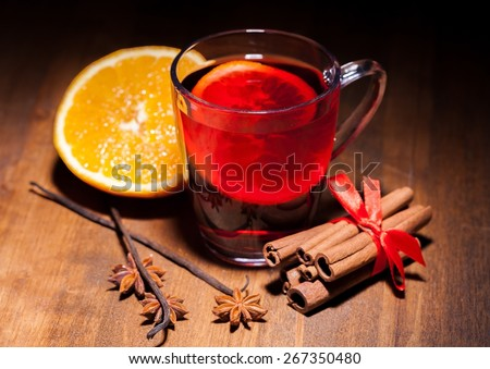 Wine. Hot wine for winter and Christmas with delicious orange and spices - stock photo