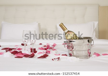 wine in bed to celebrate Valentine's Day at hotel room - stock photo