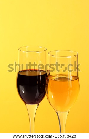 Wine in glasses  on yellow  background