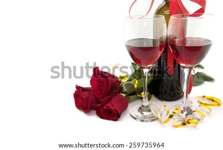 Wine in glasses, red roses and ribbon isolated on white background