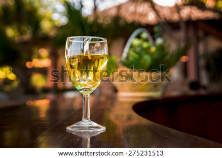 Wine in the glasses on the table. Background