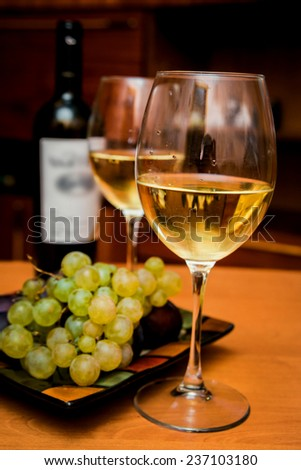 Wine in the glasses with grapes. On the table. Background