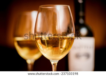 Wine in the glasses with grapes. On the table. Background - stock photo