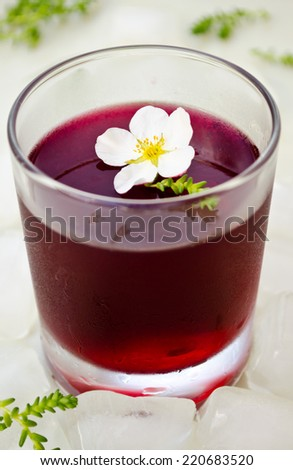 wine jelly with white flowers and ice - stock photo