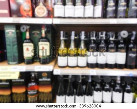 Wine Liquor bottle on shelf, Blurred background - stock photo