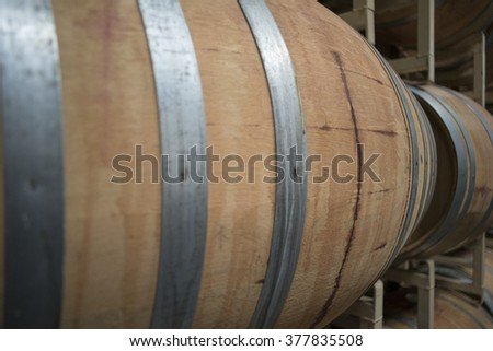 Wine-Making Aging Barrels of Vino in a Winery - stock photo