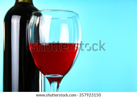Wine on blue background closeup
