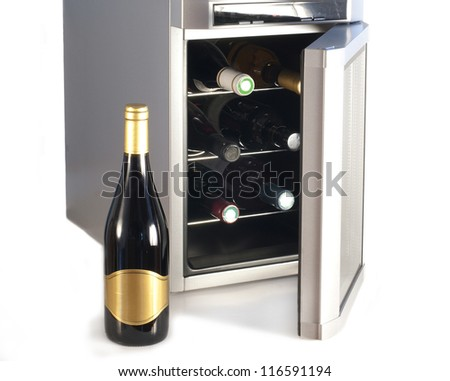Wine refrigerator and bottle of red wine - stock photo