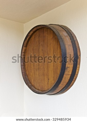 Wine round barrel on a wall, vineyard building