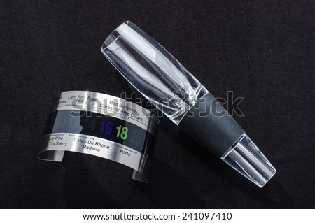 Wine serving accessories isolated on the dark background - stock photo