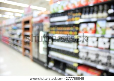 wine shelves in supermarket blurry for background - stock photo