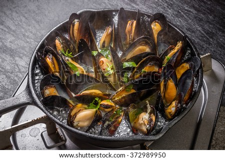 Wine steaming of the mussel - stock photo