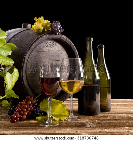 Wine still-life, glass, young vine and bunch of grapes.