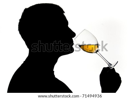 Wine tasting with human figure in silhouette and white wine - stock photo