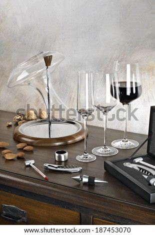 wine-tester set with decanter, glasses, thermometer and corkscrew on elegant wooden furniture. - stock photo