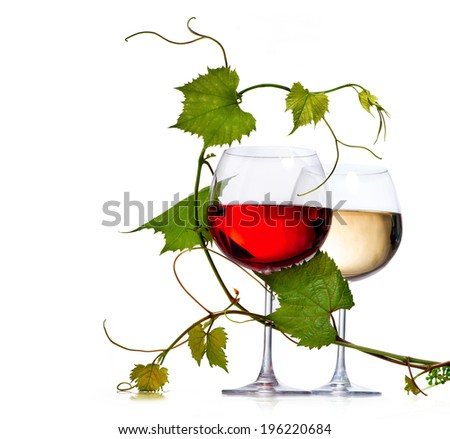 Wine. Two Glasses of red and white wine decorated with grape leaves. Glass of wine isolated on white background. Rose. Vine leaf.  - stock photo