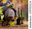 Wine with barrel on vineyard  - stock photo